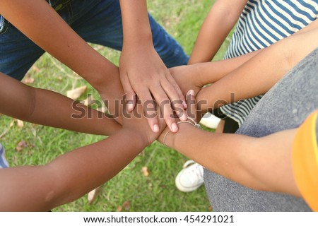 group of children putting their hands together. Team work or Kids experience concept.