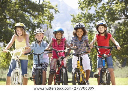 Group Of Children Riding Bikes In Countryside - stock photo