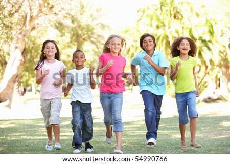 Group Of Children Running Through Park - stock photo