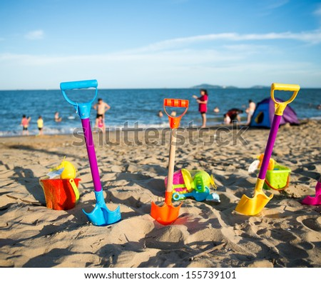 Group of children's beach toys on a sunny day. - stock photo