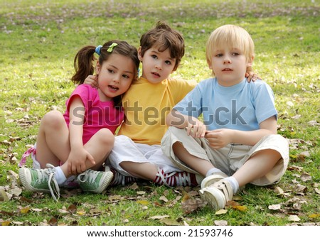 Group of children sitting in park - stock photo