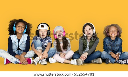 group of children studio smiling wearing headphones and winter clothes concept - Free Children Images