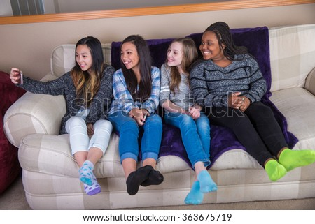 Group of children taking a selfie - stock photo