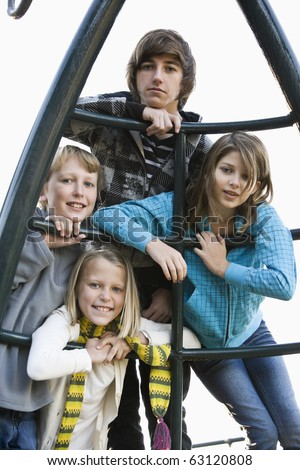 Group of children (10 to 15 years) posing together on playground