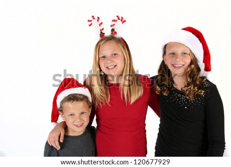 Group of children wearing festive Christmas hats - stock photo