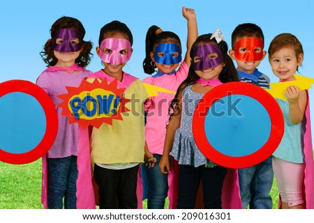 Group of children who are dressed up as superheroes - stock photo