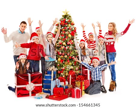 Group of children with Santa Claus and Christmas tree.  Isolated. - stock photo