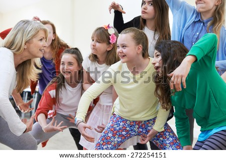 Group Of Children With Teacher Enjoying Drama Class Together - stock photo
