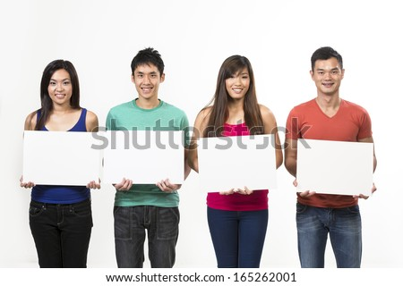 Group of Chinese people with a banner ad. Isolated on white background. - stock photo