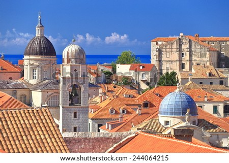Group of church towers above orange roofs in the old town of Dubrovnik, Croatia - stock photo