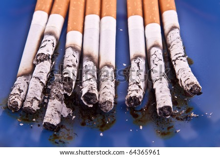 Group of cigarettes on blue background. - stock photo