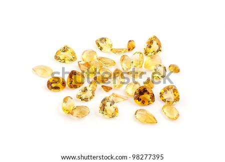 Group of citrine gemstones on white. - stock photo