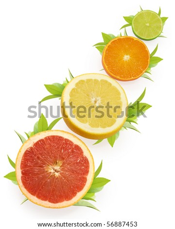 group of citrus fruits with leaves isolated on white - stock photo