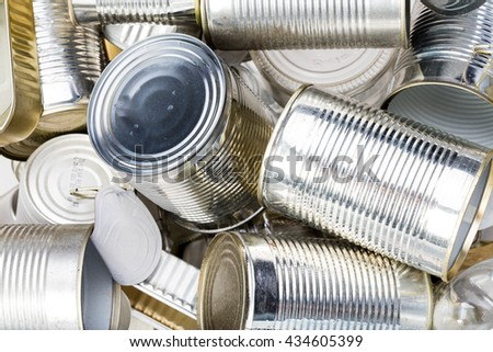 group of clean used tin can and boxes in the trash