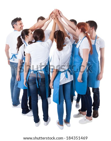Group of cleaners making high five gesture. Isolated on white - stock photo