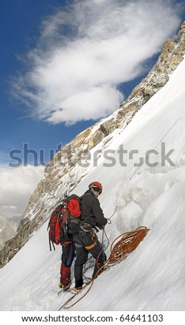 group of climbers at the Tepliy Ugol Bezenghi Ural at Caucasus mountains near Elbrus - stock photo
