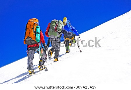 Group of climbers in the mountains - stock photo