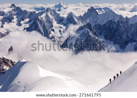 Group of climbers on the snowy slopes of the Alps