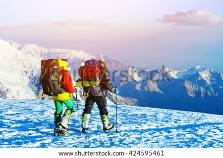Group of climbers reaching the summit. Extreme sport concept - stock photo