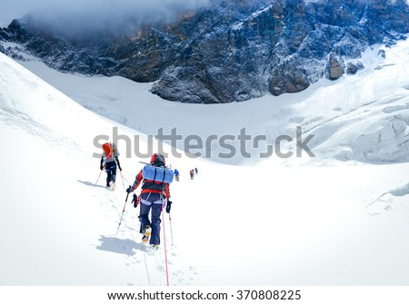 Group of climbers reaching the summit. Nepal - stock photo