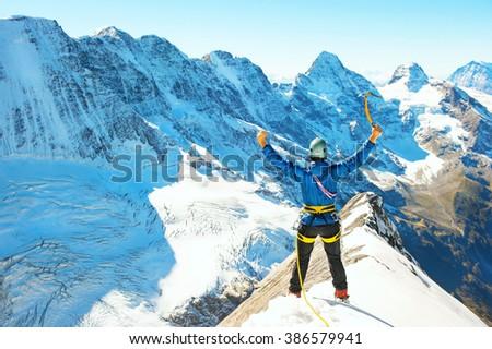 Group of  climbers reaching the summit, Nepal Himalayas - stock photo
