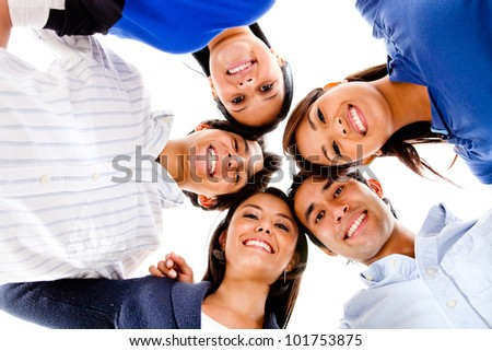 Group of close friends in a circle ans smiling - isolated - stock photo