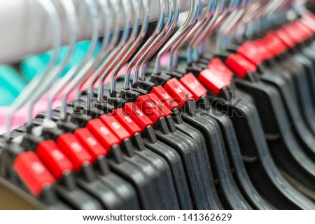 group of cloth hanger with red sizing label in angle - stock photo