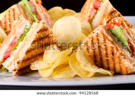 Group of club sandwiches with salmon and cucumbers on white bread - stock photo