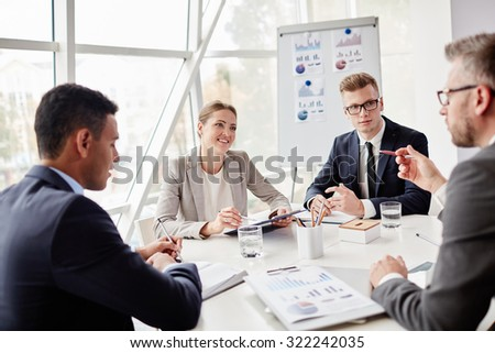 Group of co-workers consulting about data