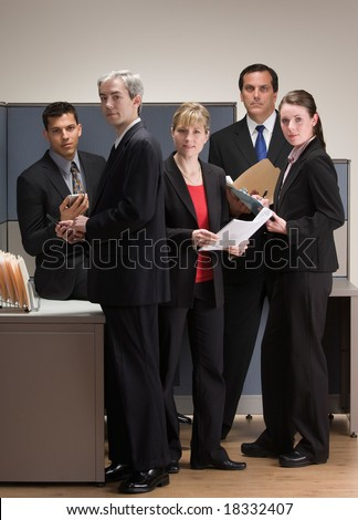 Group of co-workers meeting and working in cubicle - stock photo