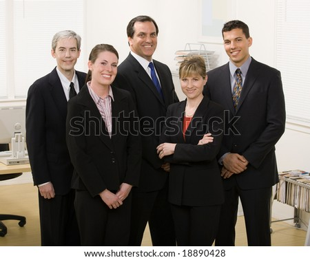 Group of co-workers posing in office - stock photo