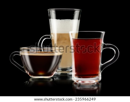 Group of coffee and tea cups over black background - stock photo