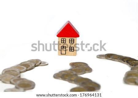 group of coins and house of white background - stock photo