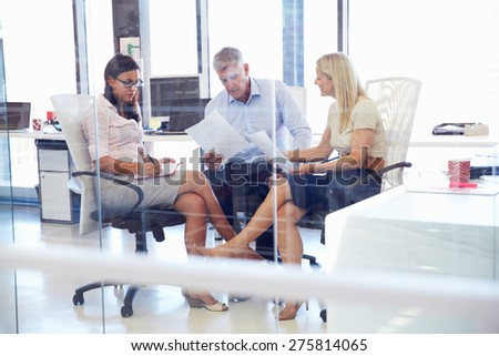 Group of colleagues talking in an office - stock photo