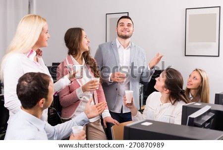 Group of colleagues 25-30 years old drinking champagne at office - stock photo