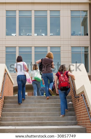 Group of College Girls Going to School - stock photo