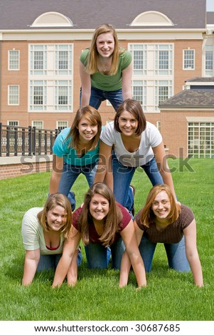 Group of College Girls In Pyramid - stock photo