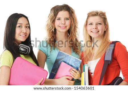 Group of college girls looking their books. Full length portrait isolated on white background - stock photo
