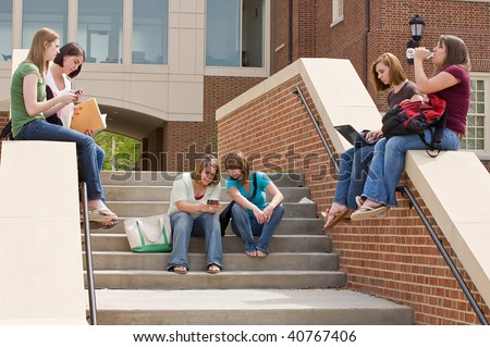 Group of college Girls on Campus Studying - stock photo
