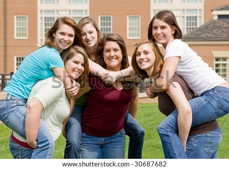 Group of College Girls Playing Around - stock photo