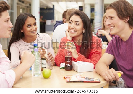 Group Of College Students Eating Lunch Together - stock photo