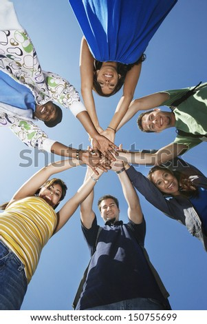 Group of college students in circle, view from below - stock photo