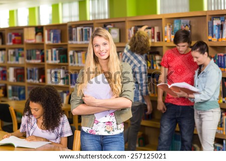 Group of college students in the library - stock photo