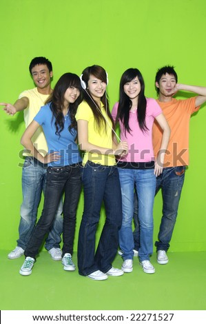 Group of college students on green background - stock photo