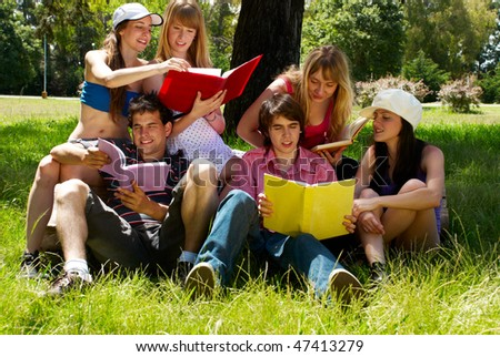 group of college students outdoors - stock photo