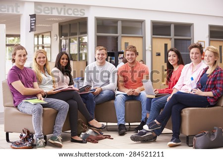 Group Of College Students Sitting And Talking Together - stock photo