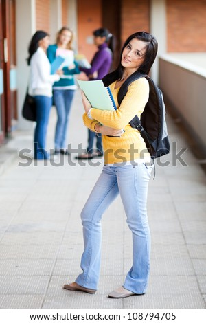 group of college students standing by corridor - stock photo