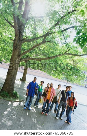 Group of college students standing together - stock photo