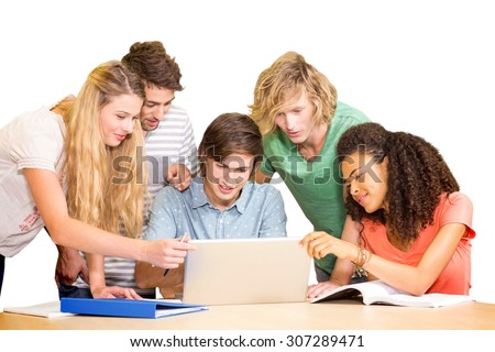 Group of college students using laptop in the library