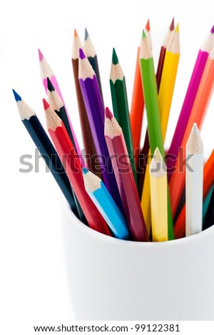 Group of color pencils in a white cup, white background, isolated - stock photo